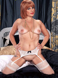 glamorous-mature-redhead-in-white-lingerie-shows-her-juicy-tits-and-opens-her-pussy