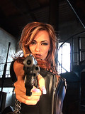 busty-babe-with-gun-gets-nude-in-the-deserted-building-and-shows-her-fine-ass