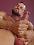 bearded-mature-cowboy-with-tight-body-and-hairy-chest-gets-naked-and-jerks-his-pistol