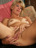 naughty-blonde-mom-in-underwear-shows-her-small-tanlined-tits-and-bushy-pussy