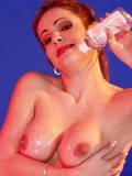 naughty-temptress-takes-off-her-red-lace-lingerie-and-rubs-oil-on-her-smooth-skin
