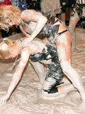 two-beautifully-dressed-ladies-take-part-in-muddy-wrestling-fight-at-the-party