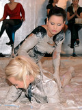 blonde-and-brunette-fight-in-the-mud-in-front-of-curious-watchers-at-fetish-party