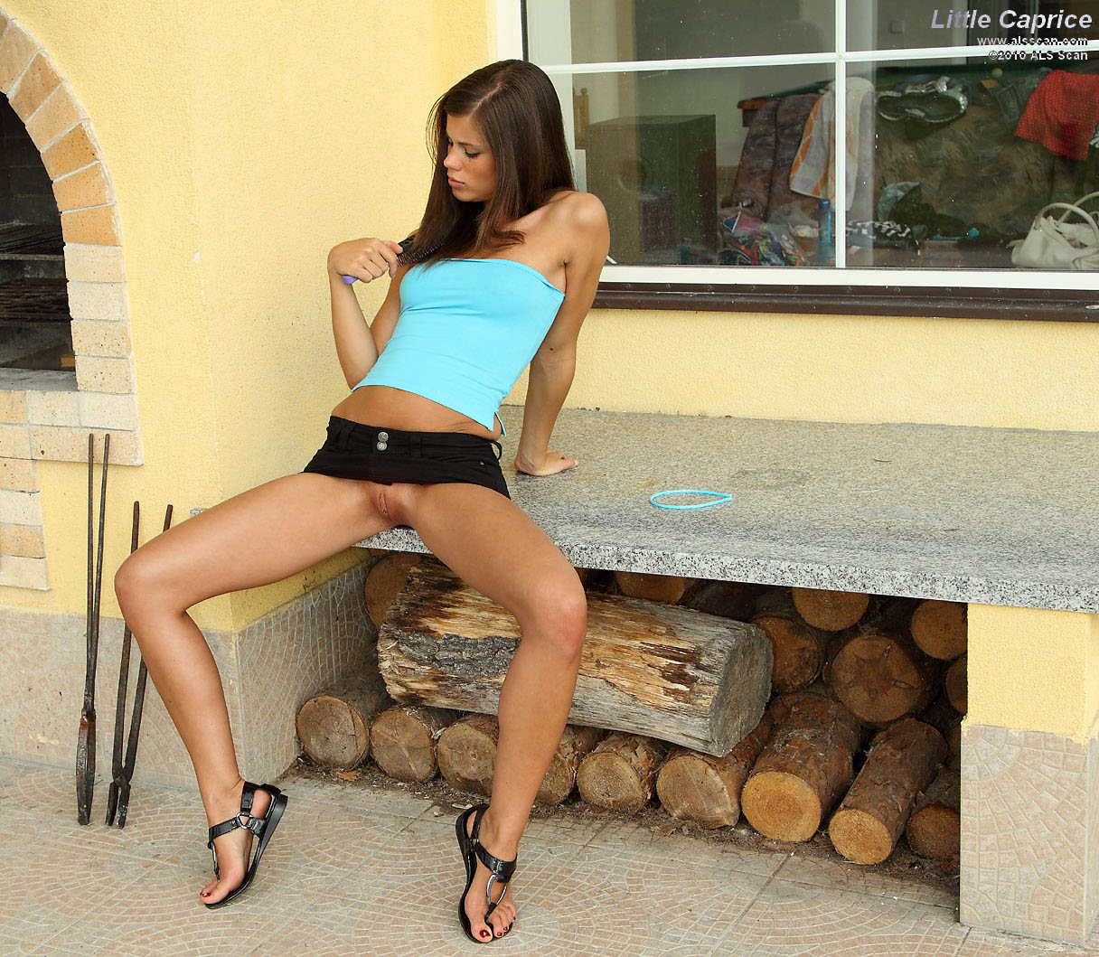 als upskirt - Long legged teen brunette with shaved tight pussy strips off her black mini  skirt