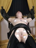 slave-lady-in-black-latex-stockings-shows-her-pierced-nipples-on-a-bondage-chair