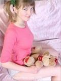 child-looking-bimbo-with-ponytails-is-posing-with-her-favorite-teddy-bear