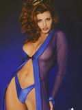 tall-flirtatious-babe-with-fine-body-lines-poses-in-super-sexy-blue-suit