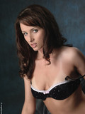 gorgeous-brunette-angelique-poses-in-black-bra-and-black-sheer-thigh-highs