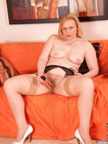 mature-blonde-in-sheer-nylons-and-black-garter-belt-masturbates-her-snatch