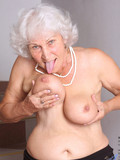 silver-haired-granny-takes-off-her-gray-dress-and-black-lingerie-on-the-stairs