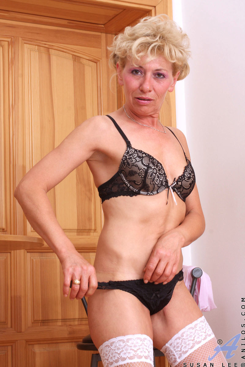 Petite Nude Mature Stunning slim blonde haired mature poses in white stockings and black bra'n