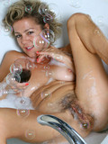 mature-woman-spreads-her-hairy-pussy-wide-open-and-masturbates-in-the-bathtub