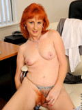 red-haired-mature-office-worker-strips-naked-and-dildos-her-amazing-hairy-pussy