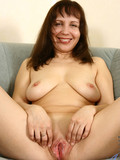 mature-woman-with-juicy-shaved-pussy-takes-off-her-black-clothes-and-poses-naked