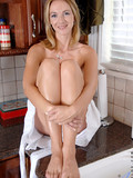 Charming fair haired milf with cute face and slim body strips out of her white dress and undies