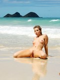 completely-nude-wet-babe-shows-her-private-parts-in-wet-sand-on-the-beach