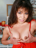 asian-lady-in-revealing-red-lingerie-shows-her-bald-pussy-and-small-tits