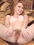 naughty-redhead-with-beautiful-face-spreads-her-natural-hairy-pussy-in-the-middle-of-a-bed