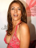 topless-photos-of-slender-celebrity-elizabeth-hurley-caught-with-bare-tits-on-the-beach