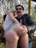slim-blonde-teen-in-ultra-short-blue-skirt-gets-her-tiny-ass-spanked-in-the-forest