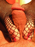 brunette-in-fishnets-and-shoes-kicks-and-tramples-man-s-balls-and-cock