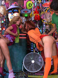 two-sexy-ladies-in-short-skirts-get-pounded-doggy-style-in-front-of-each-other