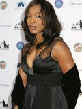 Exotic celebrity Angela Bassett gives a smile posing in various beautiful dresses