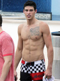 Adam Gregory with sexy tattooed muscle torso caught topless on a beach resort