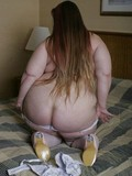salacious-bbw-in-lace-panties-and-stockings-licks-her-own-nips-and-strips-down-on-the-bed