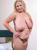 flirtatious-chubby-blonde-cutie-strips-down-to-her-sexy-tiny-panties-in-front-of-you