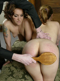 two-girls-get-their-perfectly-shaped-bare-asses-spanked-in-front-of-each-other