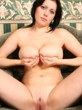 dark-haired-woman-with-amazingly-big-natural-tits-removes-her-big-size-panties