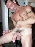 middle-aged-man-with-giant-cock-shows-his-perfectly-chiseled-nude-body