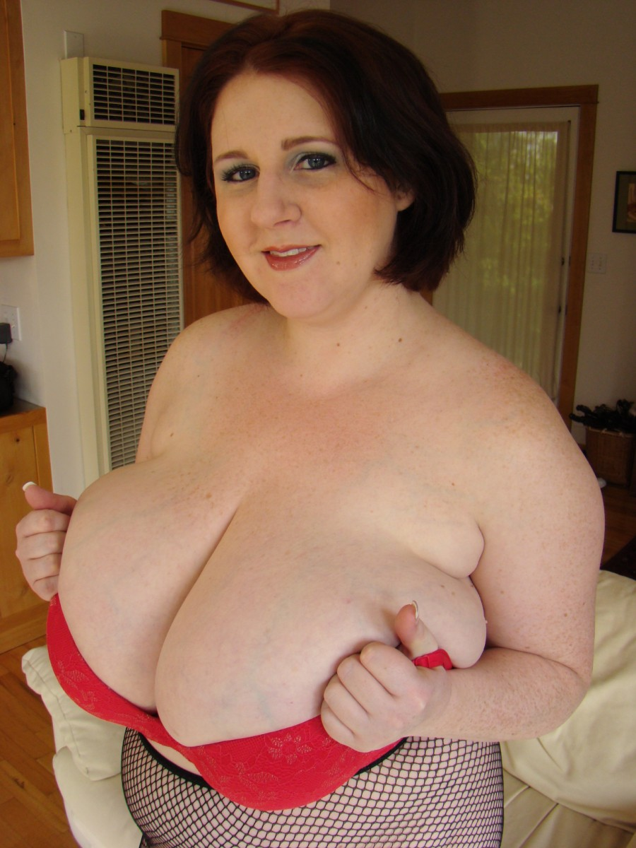 plumper in black pantyhose takes off her big bra and shows her giant