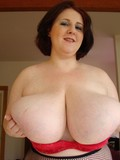 plumper-in-black-pantyhose-takes-off-her-big-bra-and-shows-her-giant-tits