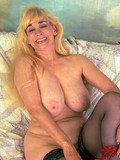 huge-breasted-mature-blonde-in-black-stockings-strips-out-of-her-red-lace-lingerie