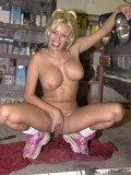 very-big-titted-female-sitting-on-her-hunkers-and-passionately-squeezing-the-boobs