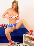 alluring-sweet-girl-shows-her-naughty-bits-while-putting-her-sneakers-on