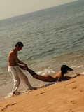 nude-obedient-brunette-gets-mouth-fucked-and-takes-brutal-guy-s-cock-in-her-pussy-in-sand