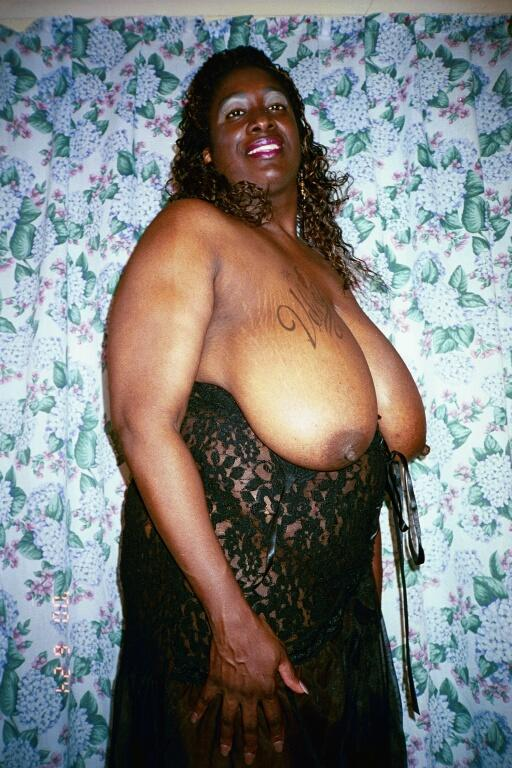 huge fat black mama - Fat mom with huge heavy melons strips nude and poses with smile on her face