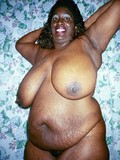 fat-mom-with-huge-heavy-melons-strips-nude-and-poses-with-smile-on-her-face