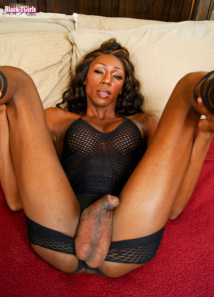 black shemales balls - Round titted black shemale takes off her sexy outfit to show her amazing  big balls