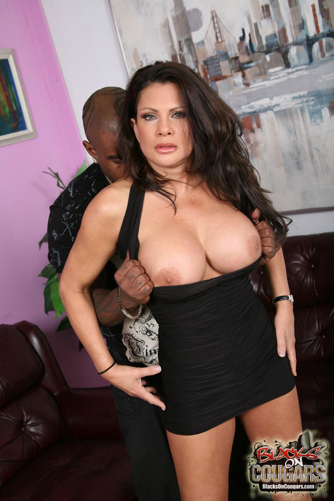 brunette milf interracial - Slutty brunette milf in black dress has interracial sex with big cocked  chocolate guy