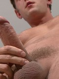 naked-muscle-man-gives-a-close-up-view-of-his-hard-cock-before-jacking-off