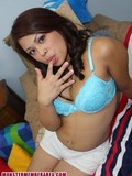 exotic-looking-teen-with-puffy-tits-and-juicy-ass-strips-and-shows-naughty-parts-in-bed