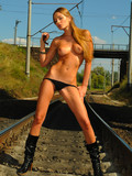 perfectly-sculptured-babe-in-boots-takes-off-her-black-panties-on-the-rail-road