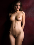 fully-nude-brunette-babe-with-beautiful-big-boobs-poses-in-the-semi-dark