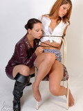 tied-up-sweet-girl-in-short-skirt-and-tiny-white-blouse-shows-her-nipples-to-dominatrix