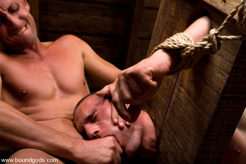 image Slave gets bound by ropes and dom puts a glove deep in her pussy