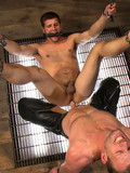 Bound gay slave gets mercilessly whipped and vigorously anal fucked in the dark of the dungeon